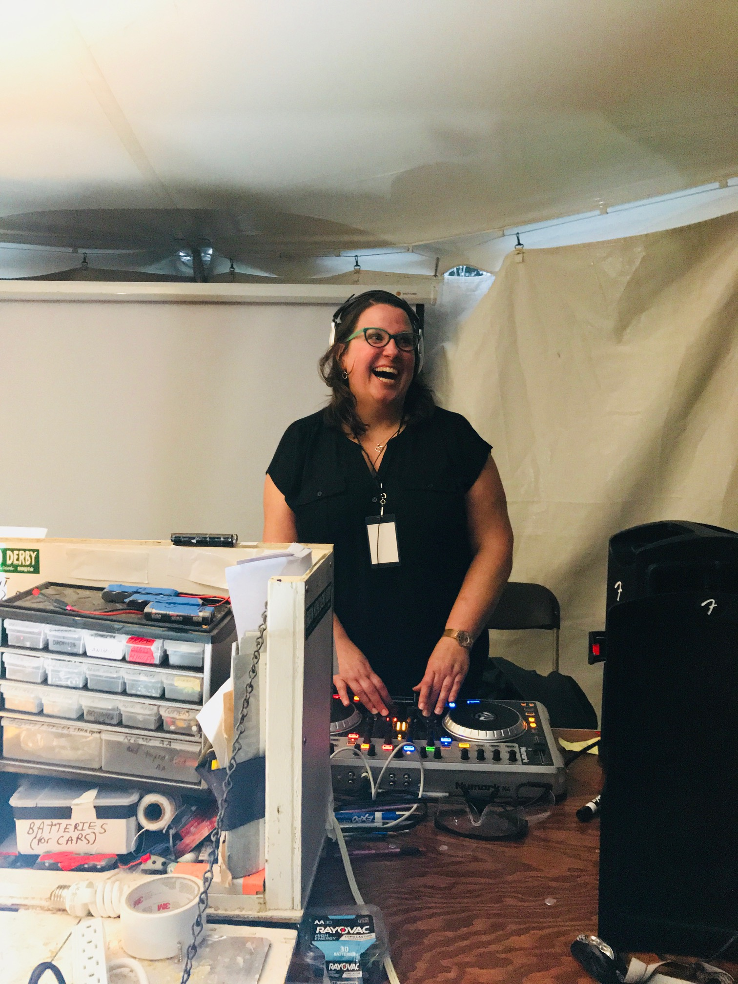 RENEW board president, Amy Heart, playing DJ at the Derby Prelim.